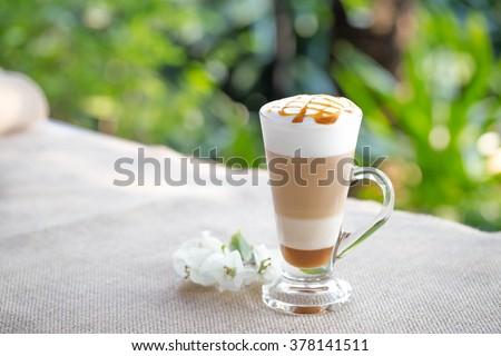 Fancy latte coffee in glass jar - stock photo