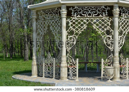 Fancy ornate gazebo in a spring park