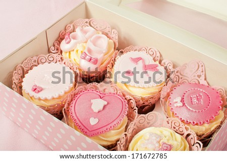 Fancy pink cupcakes - stock photo