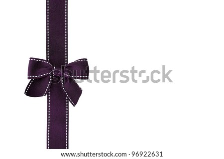 Fancy purple ribbon gift bow with white stitching on white background with room for your text - stock photo
