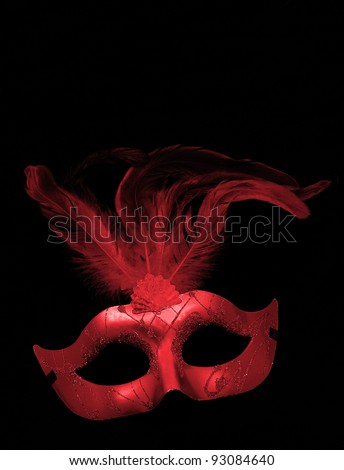 Fancy Red Feathered Mask isolated on a black velvet background - stock photo