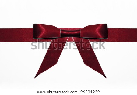 Fancy red ribbon gift bow with silver trim isolated on white background - stock photo