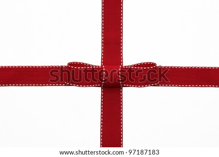 Fancy red ribbon gift bow with white stitching on white background - stock photo