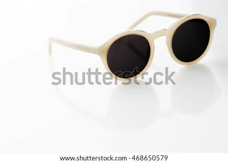 Fancy sunglasses on white background, with a copy space.