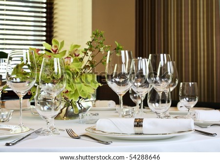 Fancy table set for a dinner - stock photo