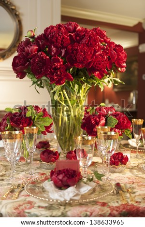 Fancy table setting with red flowers. - stock photo