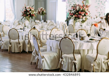 Fancy tables with the bouquets of flowers - stock photo