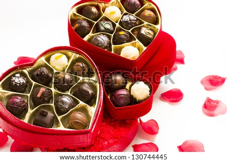 Fancy truffles in heart shaped boxes for Valentin's Day.