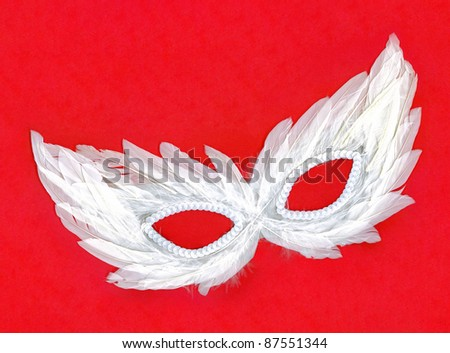 Fancy Vintage Festive White Feathers with Sequin dress mask isolated on red background