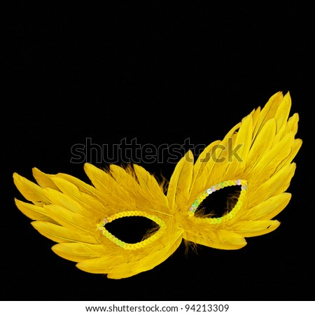 Fancy Vintage Yellow Feathers with Sequin dress mask isolated on black velvet background