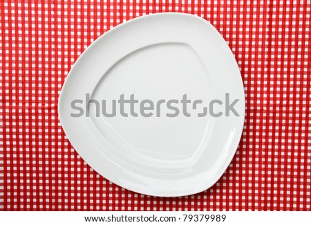Fancy White Serving Triangle Platter Plate on red and white checkered background