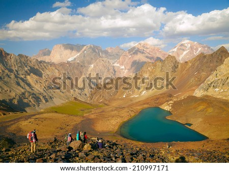 FANN MOUNTAINS, TAJIKISTAN - AUGUST 09: Tourists in the hi Fann mountains on august 09, 2014, Tajikistan.  - stock photo