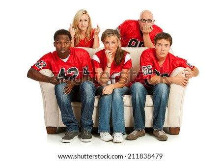 Fans: Crowd Anxiously Watches Football Game To See Who Wins - stock photo