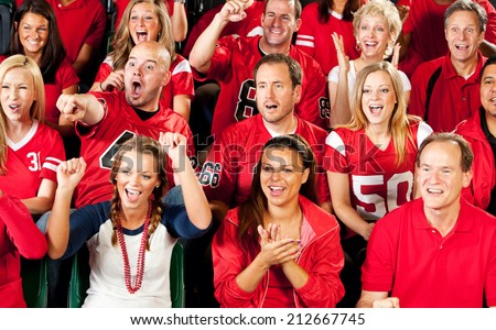 Fans: Crowd Of Cheering Football Fans In Stadium Seats - stock photo
