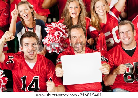 Fans: Football Fan Holds Up Blank Sign While Cheering - stock photo