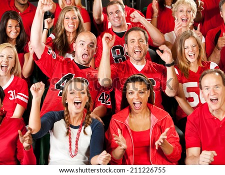 Fans: Football Fans Cheer Wildly For Their Team - stock photo