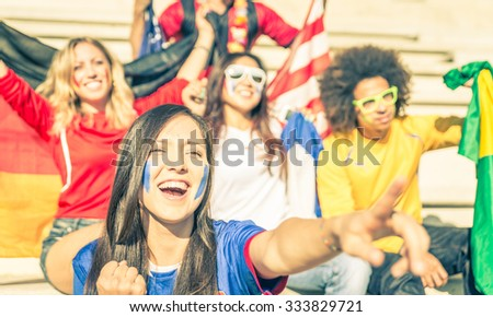 fans of different soccer teams celebrating and supporting their national teams. concept about sport and fans - stock photo