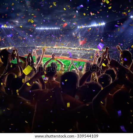 Fans on stadium game  - stock photo