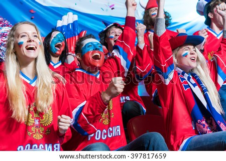 Fans on tribune indoors - stock photo