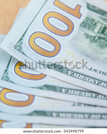 Fantail from dollar's banknotes on wooden background - stock photo