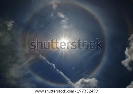 fantastic and beautiful sun halo in the sky with rainbow circle. - stock photo