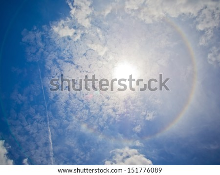 fantastic beautiful sun halo phenomenon with some cloud - stock photo