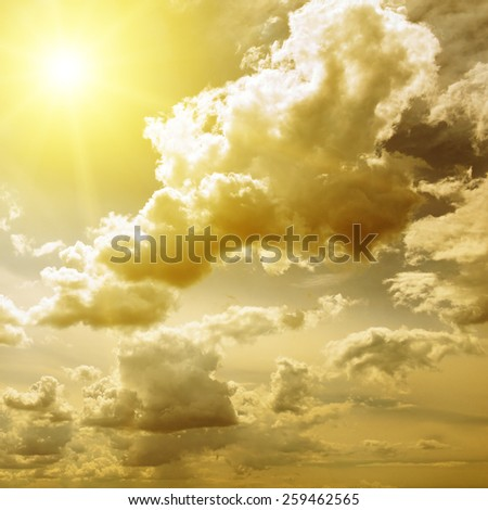 fantastic clouds illuminated by the sun - stock photo