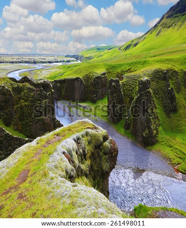 Fantastic country Iceland. The most picturesque canyon Fjadrargljufur  and the shallow creek, which flows along the bottom of the canyon - stock photo