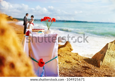 Fantastic dinner sweets near the sea on wedding day. Decoration of table. - stock photo