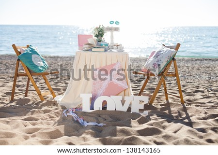 Fantastic dinner sweets near the sea on wedding day. Decoration of table - stock photo