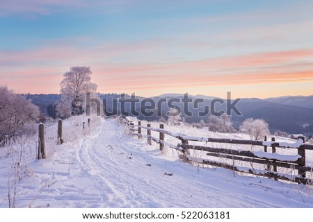 Fantastic evening winter landscape. Dramatic overcast sky. Creative collage. Beauty world.
