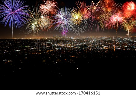 Fantastic festive new years colorful fireworks over city in celebration night - stock photo