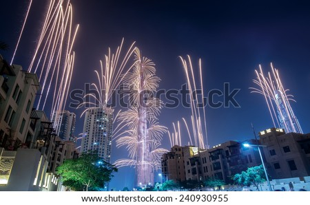 Fantastic fireworks. Dubai celebration of New Year Eve with fireworks and explosions. UAE and Dubai best fireworks show. Arabic firework show in desert. - stock photo