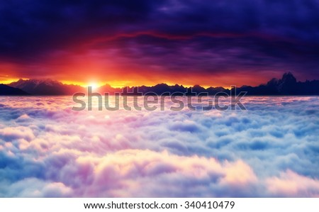 Fantastic foggy landscape glowing by sunlight in the morning. Dark overcast sky. Dramatic and picturesque scene. Location Svaneti, Georgia, Europe. Beauty world. Instagram toning effect.  - stock photo