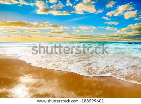 Fantastic golden sand beach with blue water. - stock photo