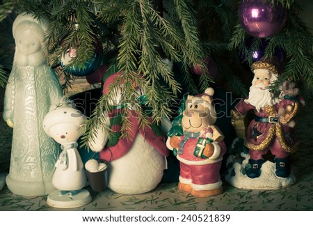 Fantastic heroes: Snow Maiden, Snowman, Santa Claus under the Christmas tree - stock photo