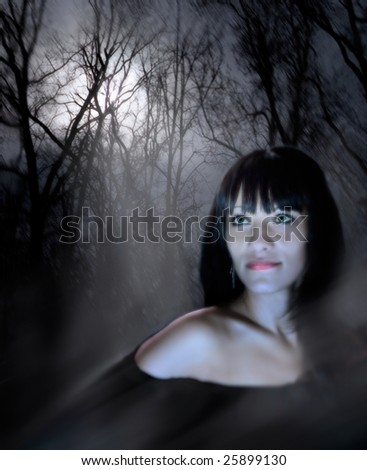 Fantastic history about a young and beautiful witch. Green eyes of the woman radiate force of character. A background - a night wood in a mysterious fog. Through trees the moonlight makes the way. - stock photo
