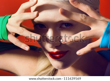fantastic lady whit red lips on red background magik look at camera - stock photo