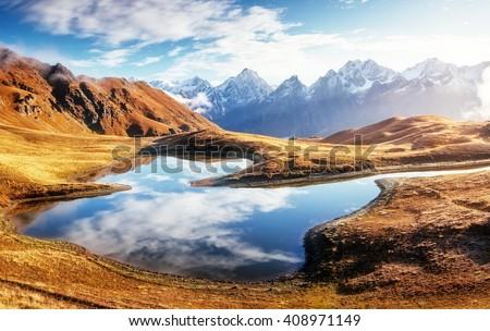 Fantastic lake Koruldi at the foot of Mt. Ushba. Dramatic scene. Location famous place Upper Svaneti, Mestia, Georgia, Europe. High Caucasus ridge. Warm toning, soft filter effect. Beauty world. - stock photo