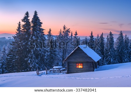 Fantastic landscape glowing by sunlight. Dramatic wintry scene with snowy house. Carpathians, Ukraine, Europe. - stock photo