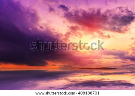 fantastic landscape. The dramatic scene sunset over a lake, rays erupt through the heavy storm clouds reflected in the water. color in nature. - stock photo