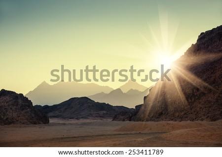 Fantastic landscape with mountains at sunset. Arabian desert, Egypt. Creative toning effect - stock photo