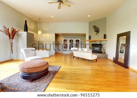 Fantastic modern living room home interior. Huge green bright room with modern furniture. - stock photo
