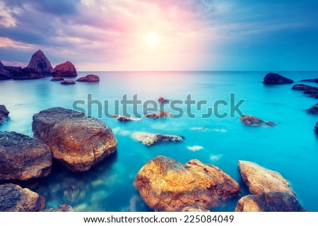 Fantastic morning blue sea glowing by sunlight. Dramatic scene. Black Sea, Crimea, Ukraine, Europe. Beauty world. Retro style filter. Instagram toning effect. - stock photo