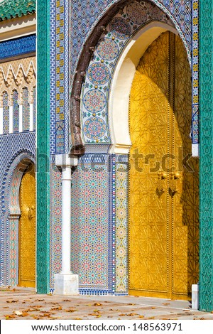Fantastic mosaic tiled entry with golden doors at the Royal Palace in Fez, Morocco. Islamic design and pattern. - stock photo