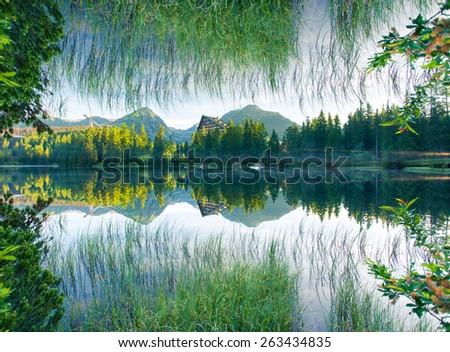 Fantastic mountain lake in National Park High Tatra. Dramatic scenery. Strbske pleso, Slovakia, Europe. Beauty world. Flip canvas vertical. Double exposure effect. - stock photo
