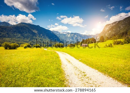 Fantastic panorama on the Triglav national park, located in the Bohinj Valley of the Julian Alps. Sky glowing by sunlight. Dramatic unusual scene. Slovenia, Europe. Beauty world. - stock photo