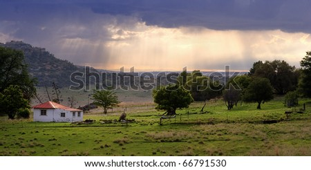 Fantastic panoramic view of house and rain in background - stock photo