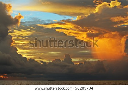 Fantastic sky (original colours) iluminated by the sunset light before the rain over the ocean. Maldives. - stock photo