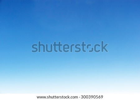 Fantastic soft white clouds against blue sky background - stock photo